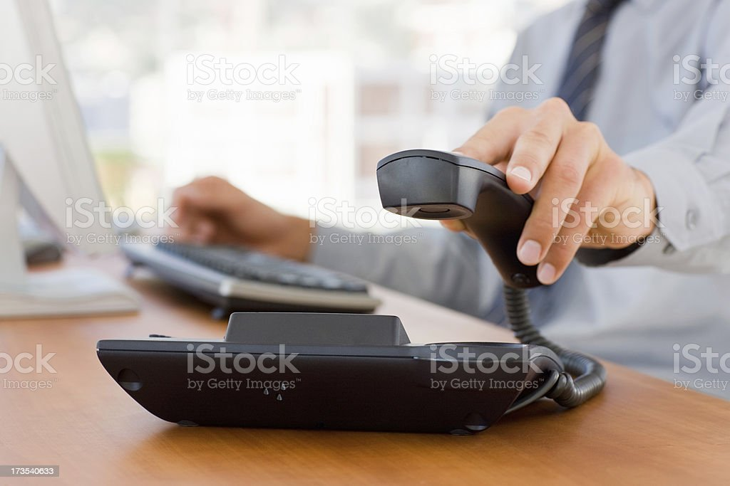 Hand holding business telephone stock photo