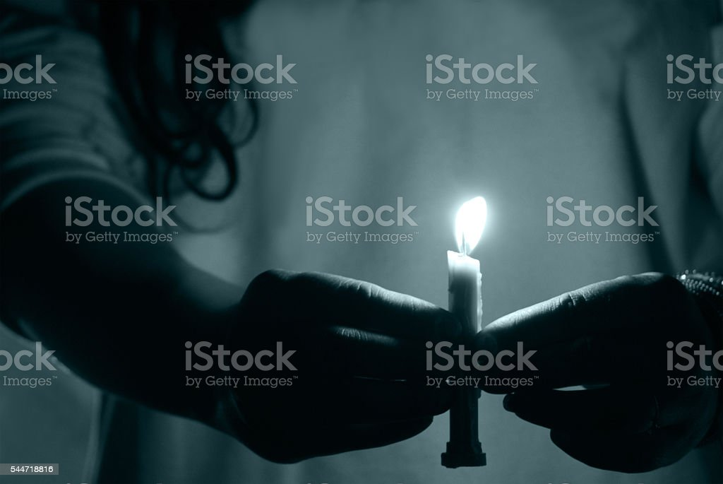 hand holding candle stock photo