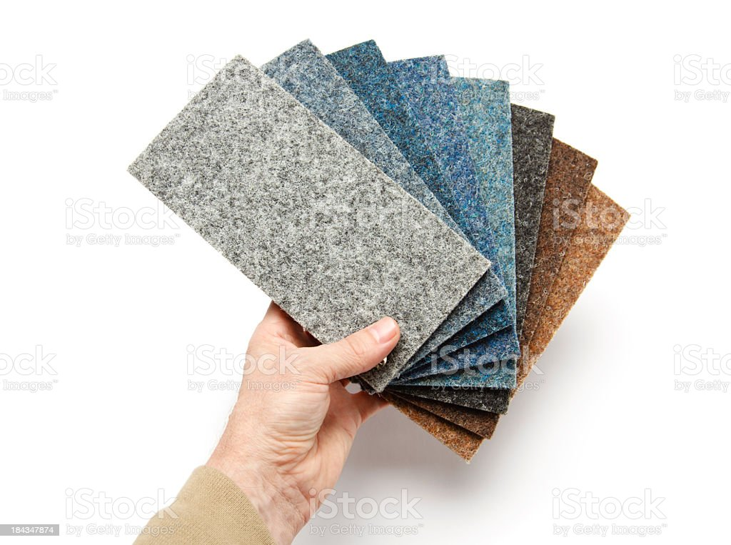 Hand holding carpet samples stock photo