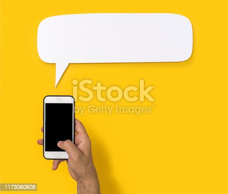 1084491176 istock photo Hand holding cell phone with blank screen 1173060926