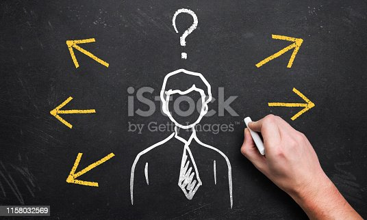 865186916 istock photo Hand holding chalk and drawing arrows around a person 1158032569