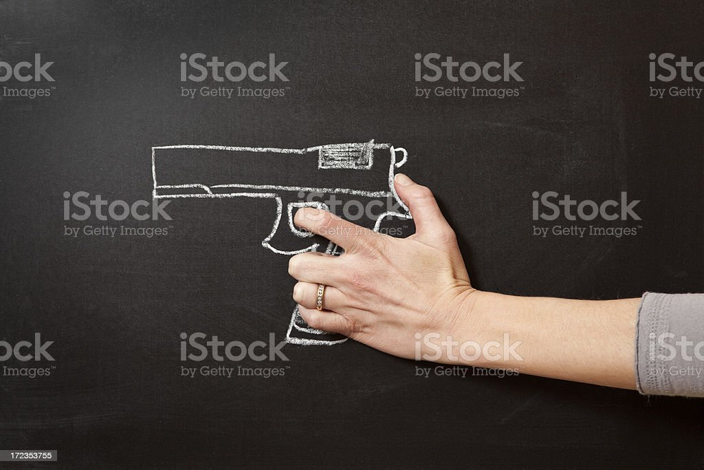 Hand Holding Chalk Drawn Gun royalty-free stock photo