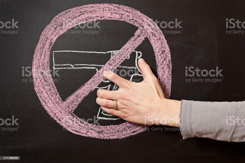 Hand Holding Chalk Drawn Gun With
