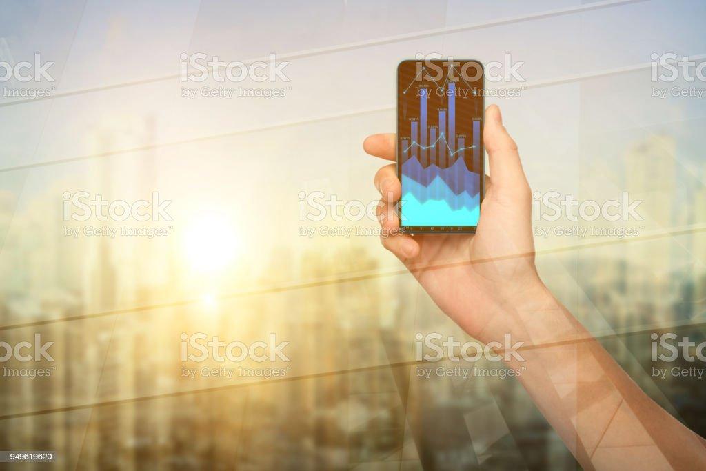 Hand holding chart smartphone stock photo