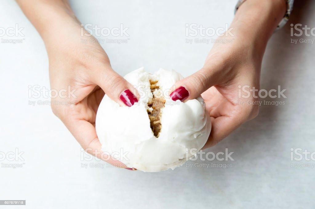 Hand holding Chinese bun stock photo