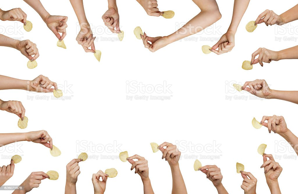 hand holding chips stock photo