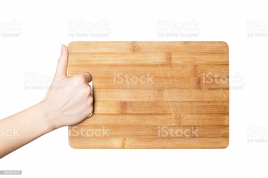 hand holding chopping board stock photo