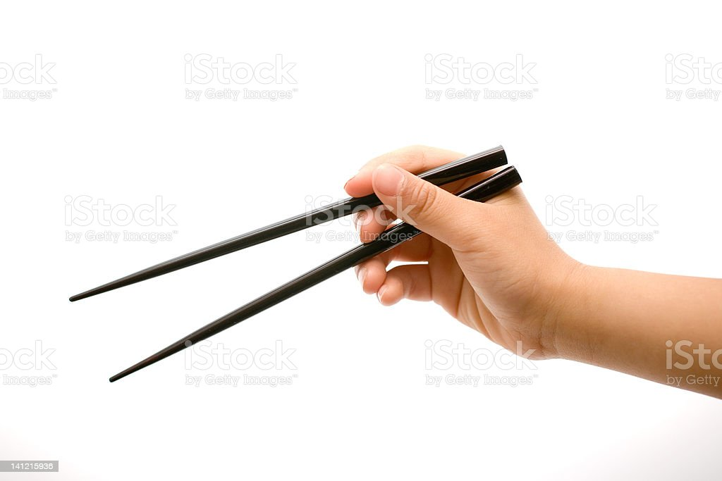 Hand Holding Chopsticks stock photo