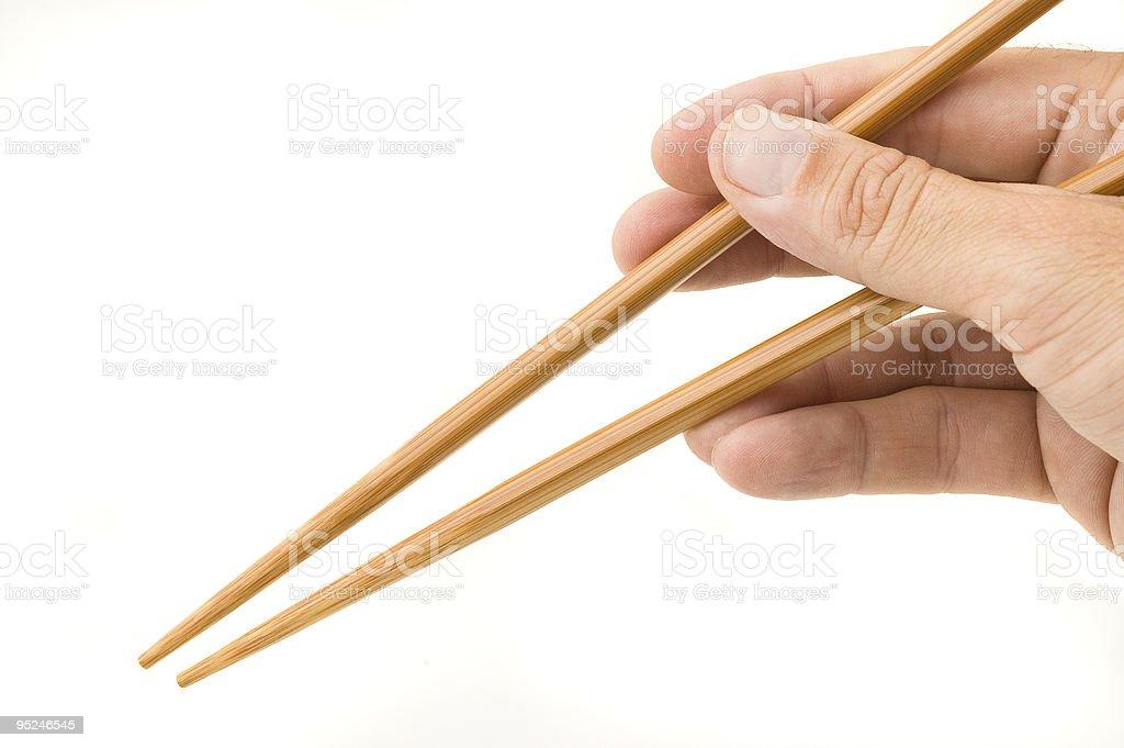 Hand holding chopsticks. royalty-free stock photo