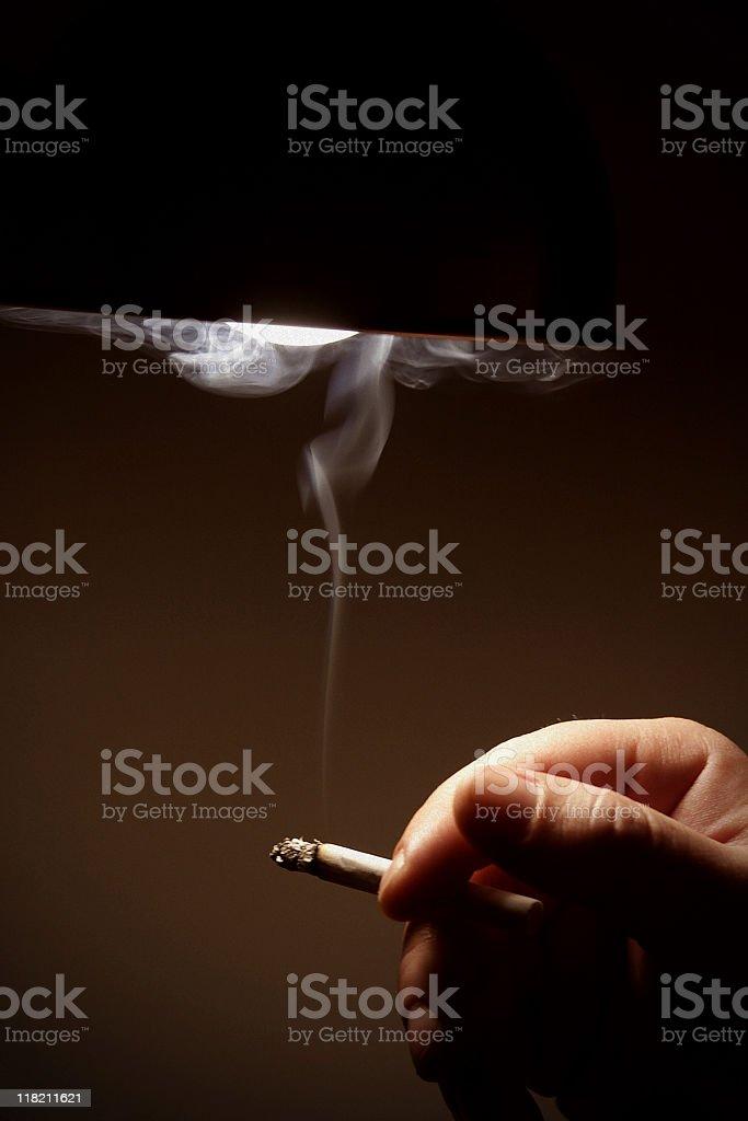Hand Holding Cigarette - Backlit Smoke stock photo