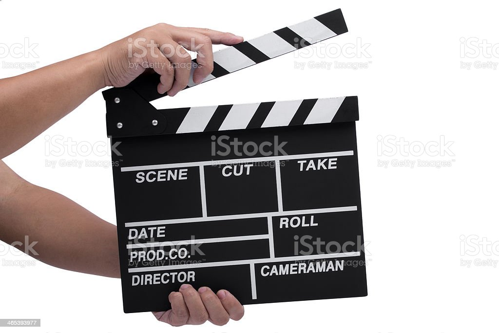 Hand holding clapperboard over white background stock photo