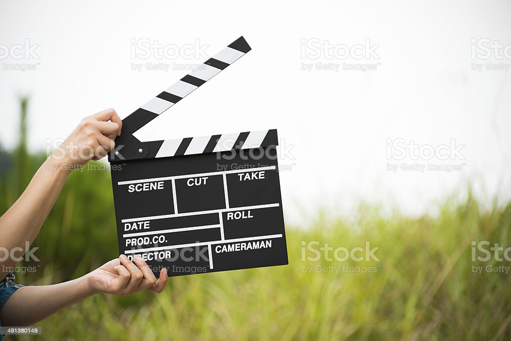 Hand Holding Clapperboard stock photo