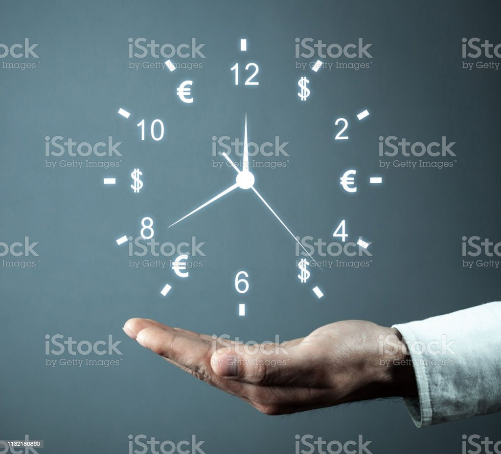 Hand holding clock. Time is money. Business time management