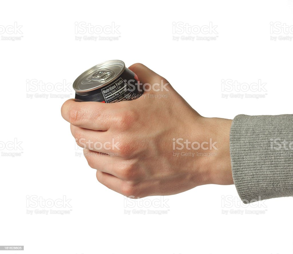Hand holding closed can of soda stock photo