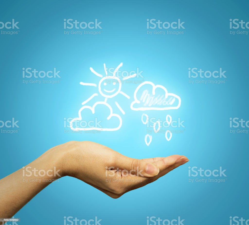 hand holding cloud sun rain icons, symbols stock photo
