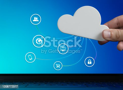istock Hand holding cloud with remote digital connectivity icons concept 1208772077