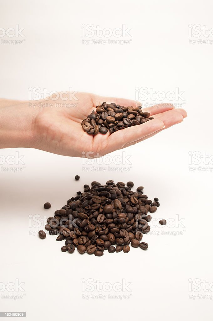 hand holding coffee beans royalty-free stock photo