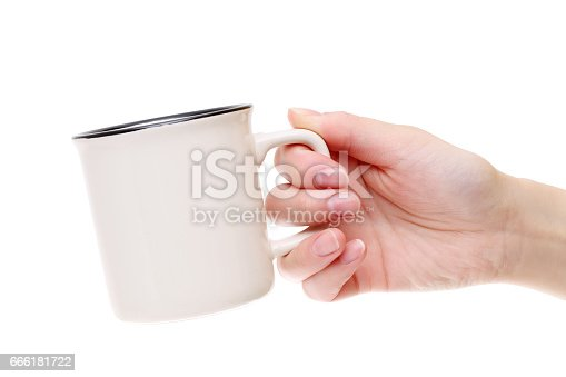 Hand holding coffee cup isolated on white background