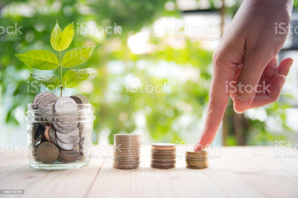 Hand holding coin with set coin stack, Concept Business and finance saving royalty-free 스톡 사진