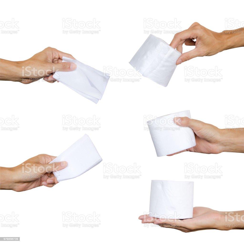 Comment Rouler Les Serviettes De Bain photo libre de droit de main tenant la collection de papier