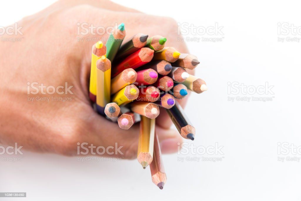 hand holding color pencil stock photo