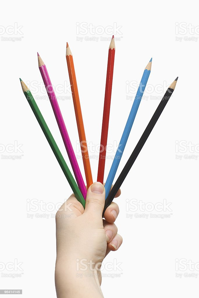hand holding colored pencils royalty-free stock photo
