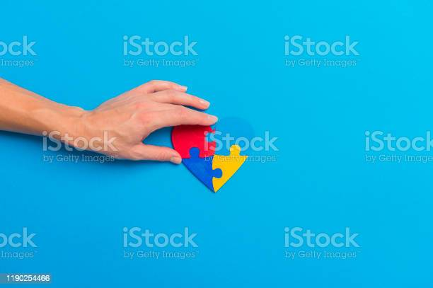Hand holding colorful heart on blue background world autism awareness picture id1190254466?b=1&k=6&m=1190254466&s=612x612&h=djaazs4lhzi3sw69e0ucsv5br7zpqc6wnsyhqgiko7s=