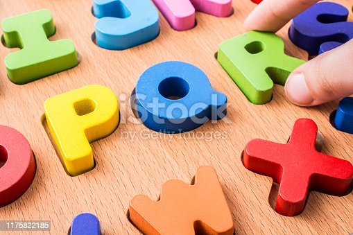 istock Hand holding Colorful Letters R made of wood 1175822185