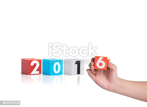 istock hand holding colorful plastic of year numbers on a white 504257616