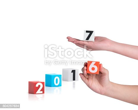 istock hand holding colorful plastic of year numbers on a white 504257634