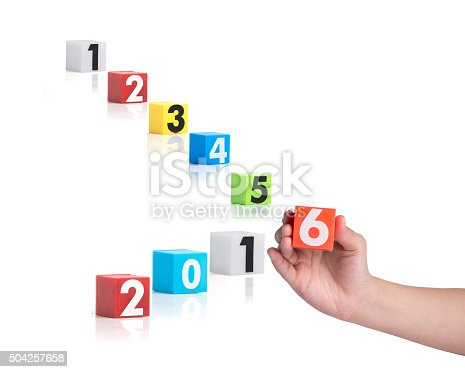 istock hand holding colorful plastic of year numbers on a white 504257658