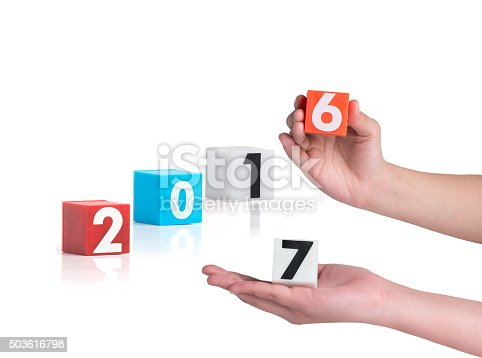 istock hand holding colorful plastic of year numbers 503616798