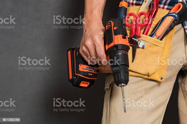 Hand Holding Construction Tools Stock Photo - Download Image Now