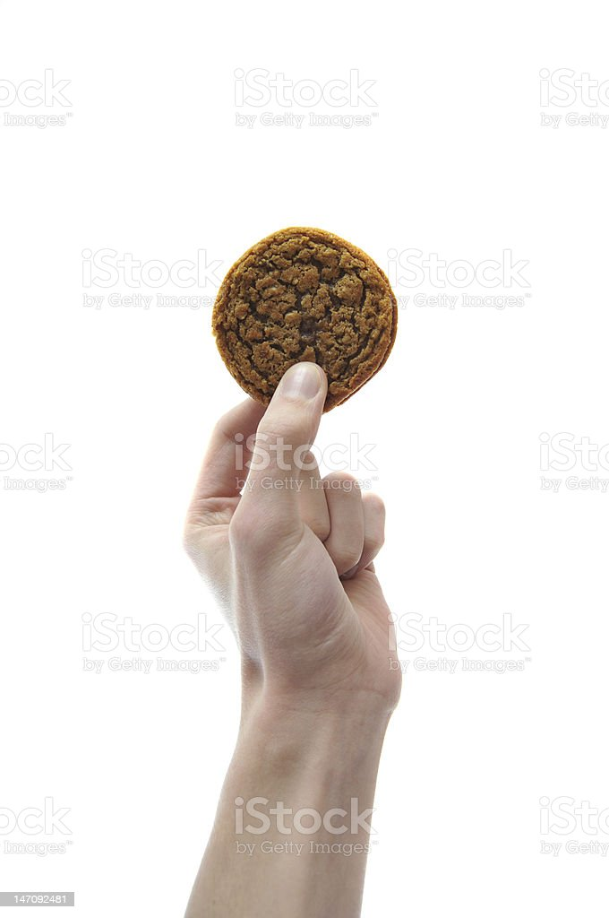 Hand holding cookie in mid air isolated on white stock photo
