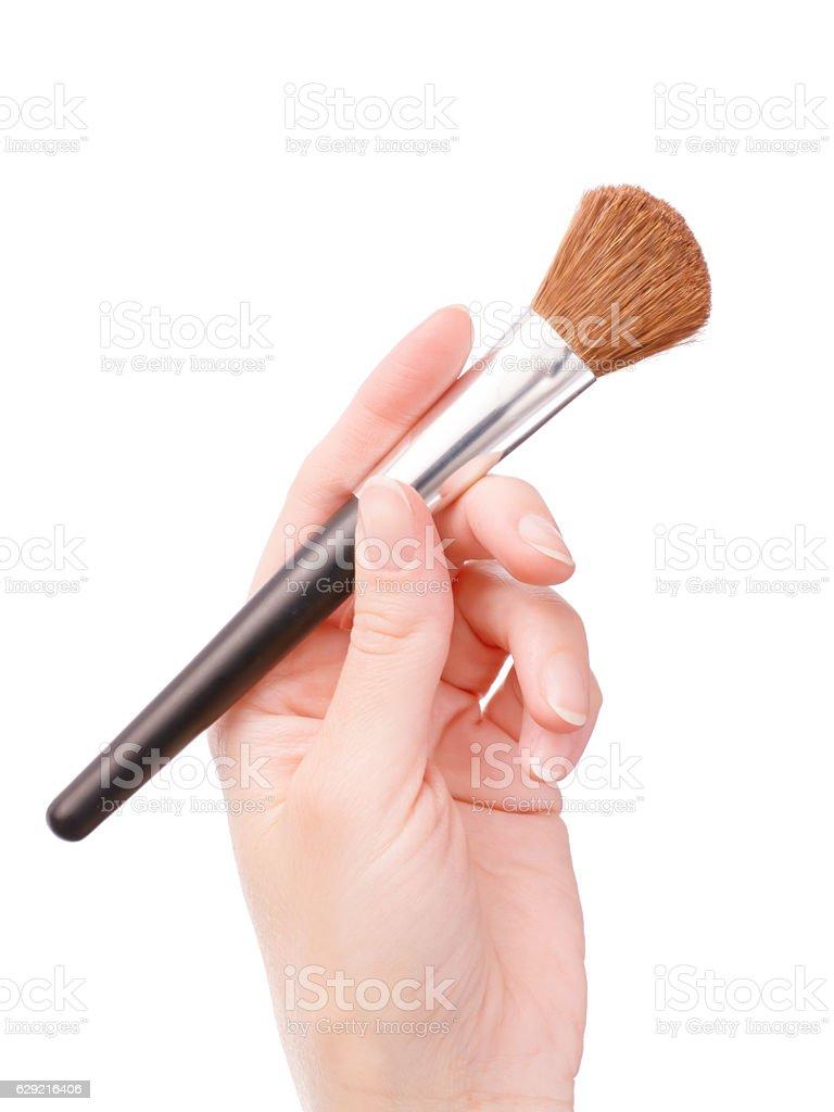 Hand holding cosmetic brush - foto de stock