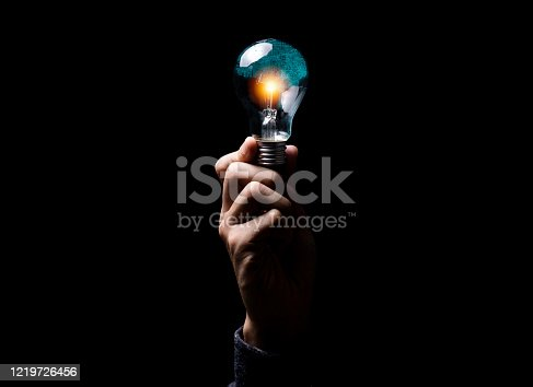 881350654 istock photo Hand holding creativity illustration electronic circuit brain inside lightbulb. It is artificial intelligence and AI technology concept. 1219726456