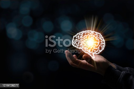 881350654 istock photo Hand holding creativity illustration electronic circuit brain. It is artificial intelligence and AI technology concept. 1219726277