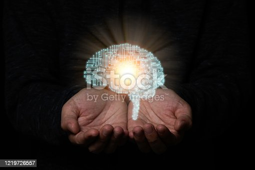 881350654 istock photo Hand holding creativity illustration electronic circuit brain. It is artificial intelligence and AI technology concept. 1219726557