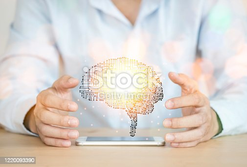 881350654 istock photo Hand holding creativity illustration electronic circuit brain. It is artificial intelligence and AI technology concept. 1220093390