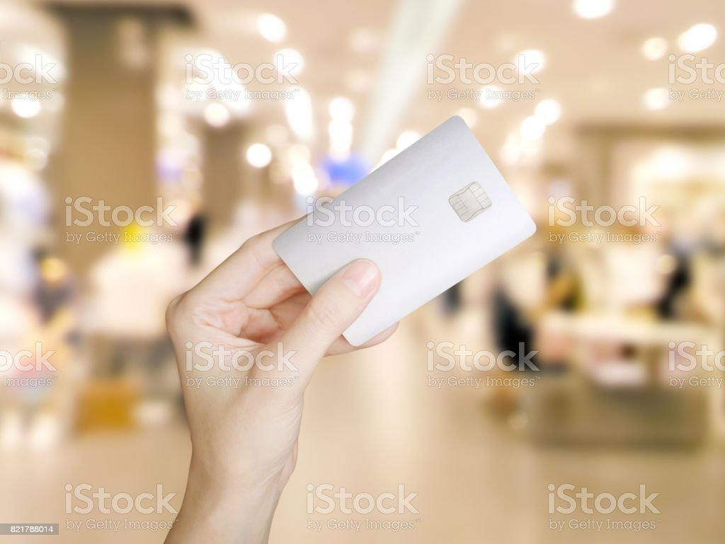 Hand holding credit card stock photo