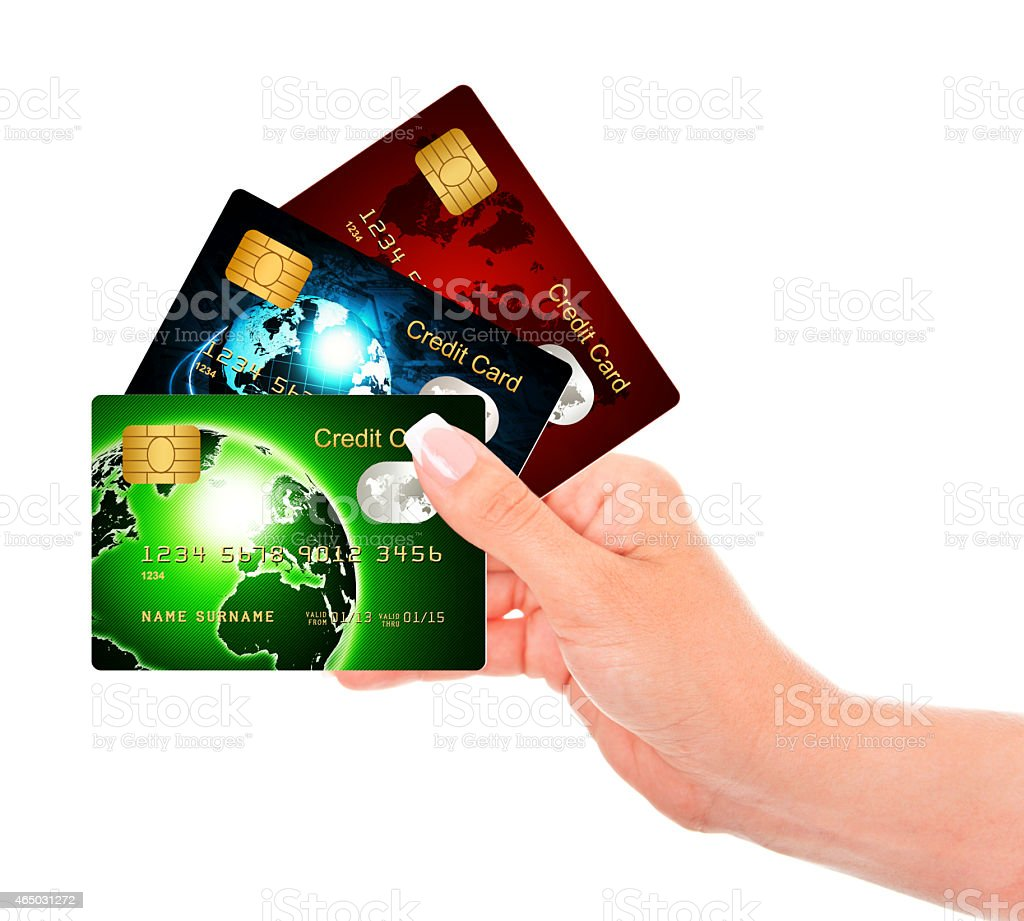 hand holding credit cards isolated over white stock photo