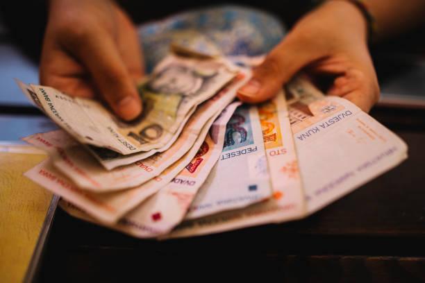 Hand holding Croatian kuna currency stock photo