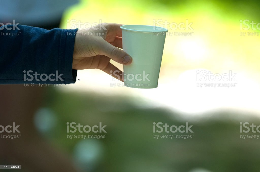 Hand holding cup at Marathon Race royalty-free stock photo