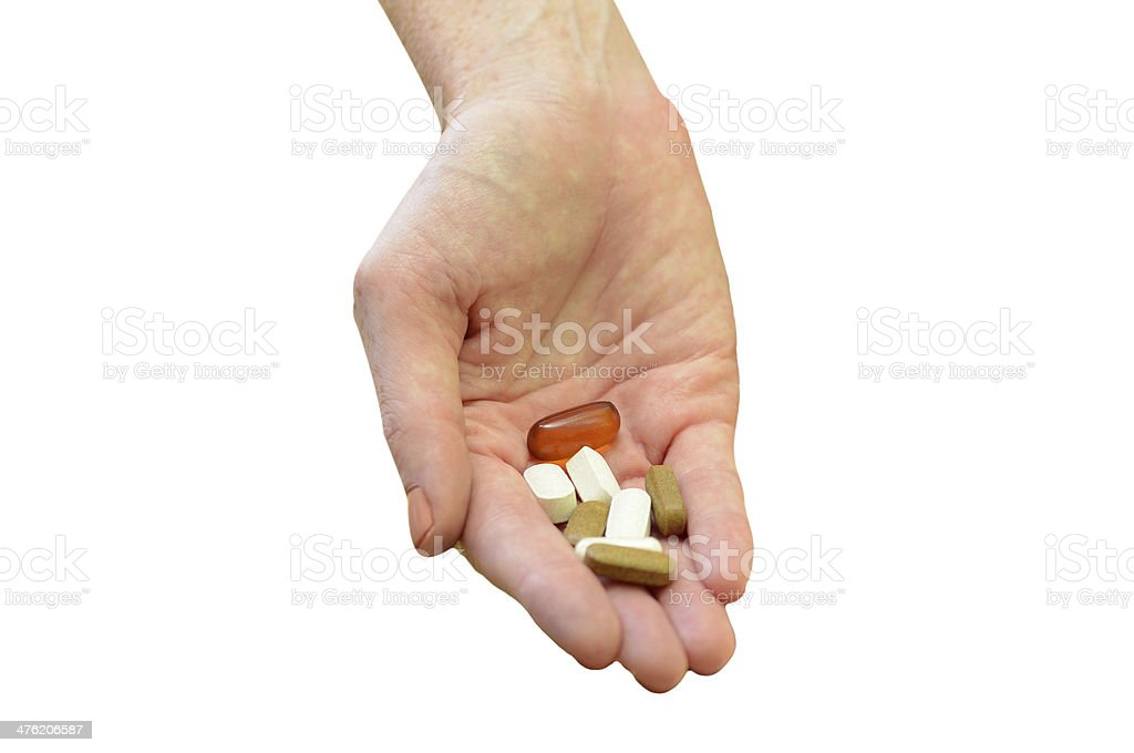 hand holding daily vitamins or medicine royalty-free stock photo