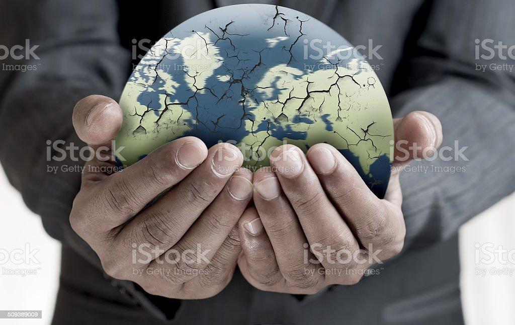 Hand holding damaged earth stock photo