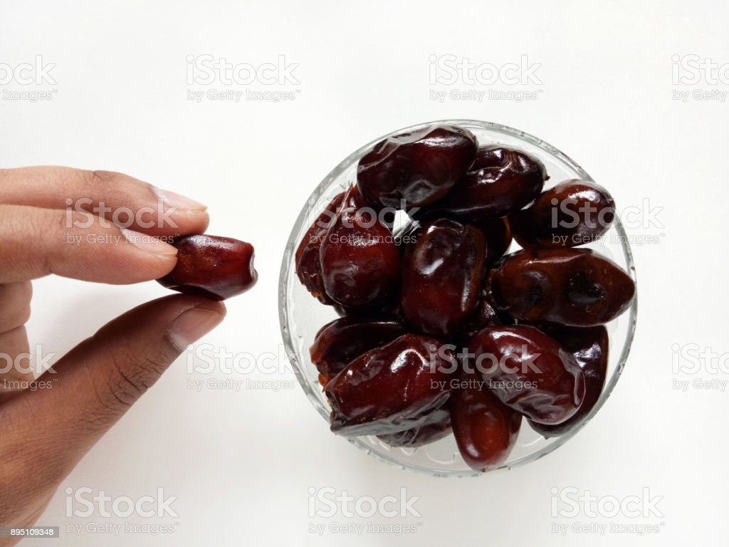 Hand Holding Dates Dry Fruit Natural and Healthy stock photo