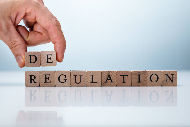Hand Holding De Near Regulation Word Hand Holding De Near Regulation Word. Deregulation Concept deregulation stock pictures, royalty-free photos & images