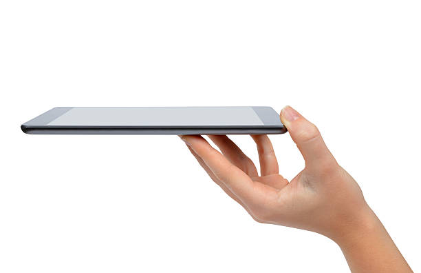 hand holding digital tablet pc stock photo
