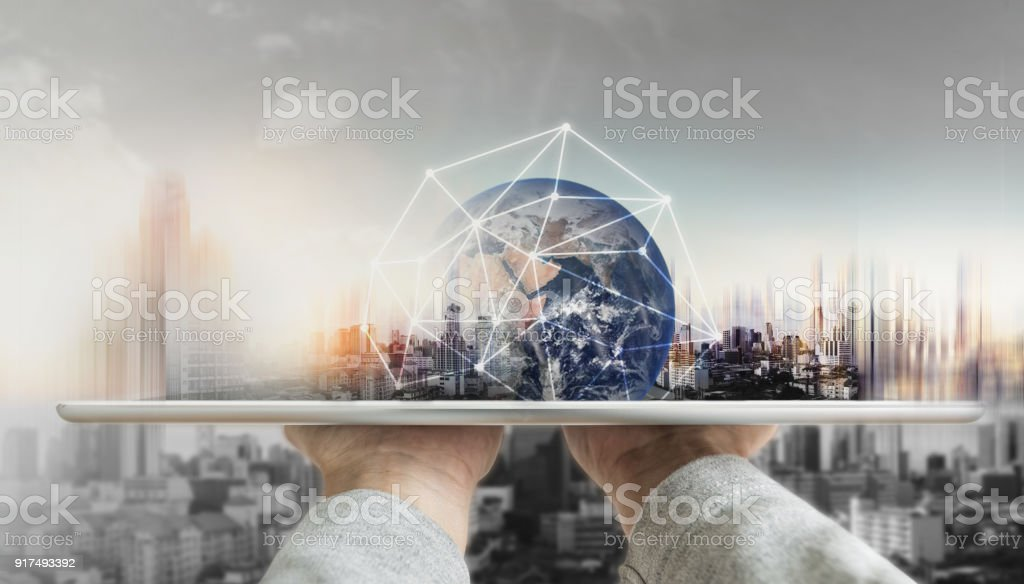 Hand holding digital tablet with global network connection technology and modern buildings. Element of this image are furnished by NASA stock photo