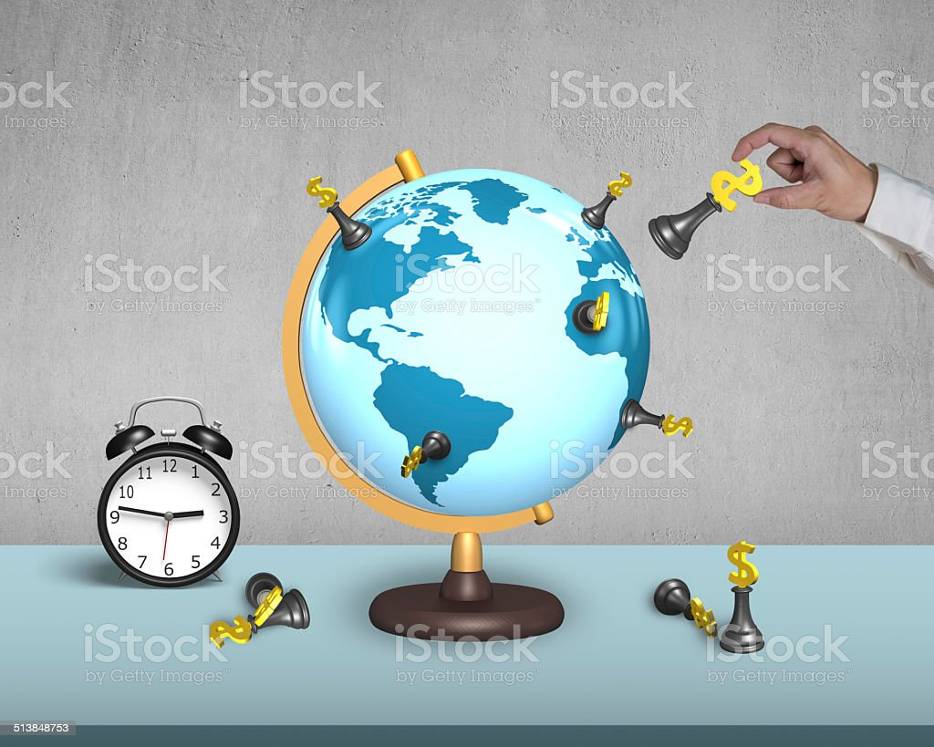 hand holding dollar chess on globe with alarm clock stock photo
